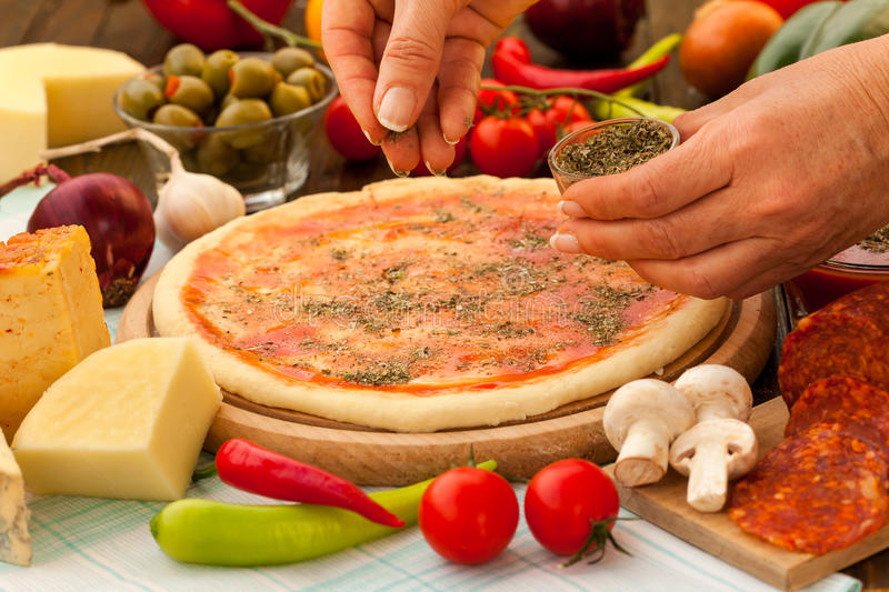 how to use fresh oregano in pizza
