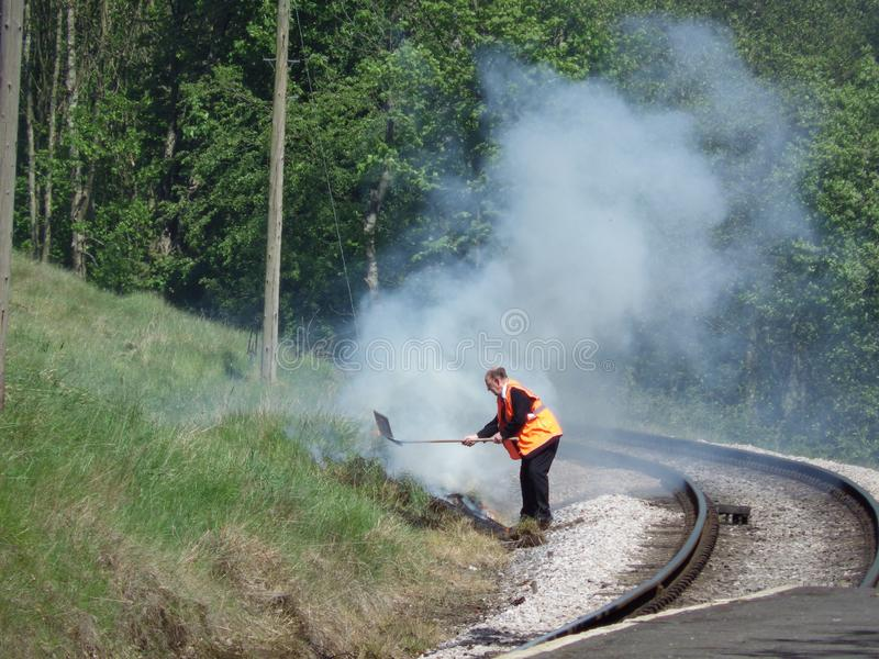 Putting out a trackside fire - Howarth Station royalty free stock photo