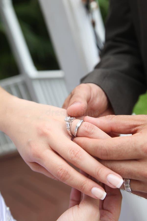 Putting on wedding ring royalty free stock photos