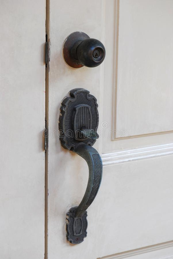 Puxador da porta e botão fotografia de stock