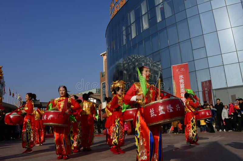 Puyang, Henan Province, China: The performance of `Battle Drum` by the women`s gongs and drums team of Shuixiu Celebration, in whi royalty free stock photo