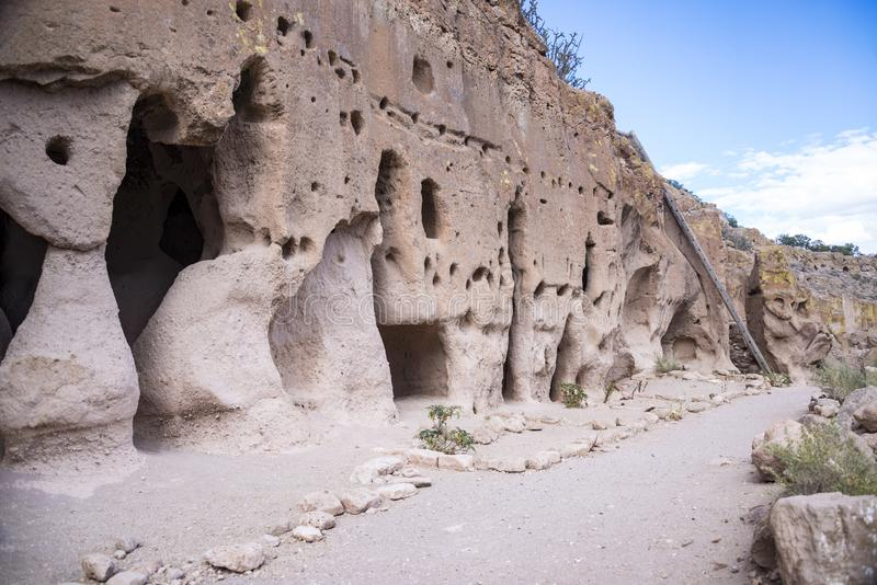 Puye Cliff Dwellings are caves and adobe ruins where ancient pueblo people, called Anasazi, lived in New Mexico. USA royalty free stock photos