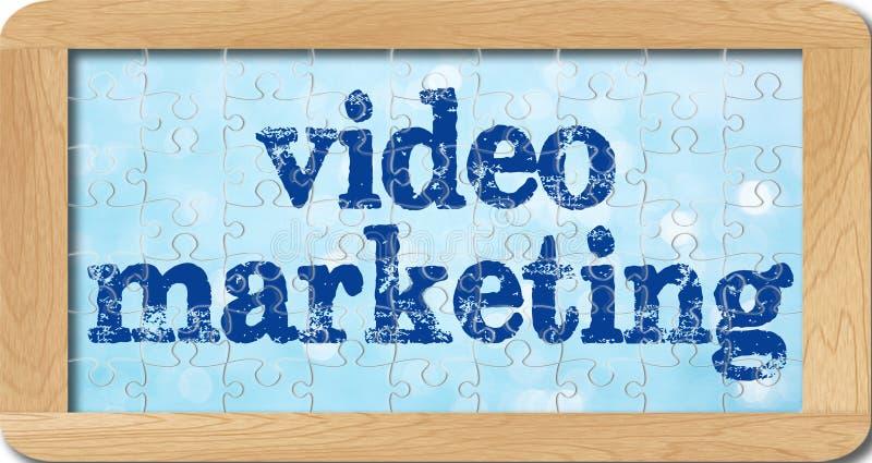 Puzzel van video marketing in houten kader stock foto