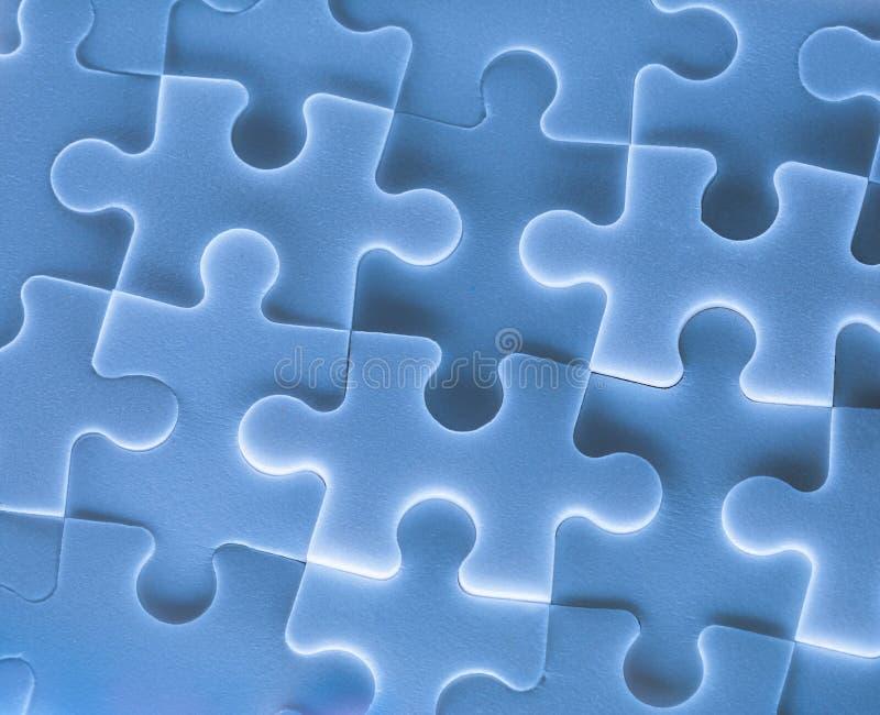 Puzzelstukken als achtergrond royalty-vrije stock afbeeldingen