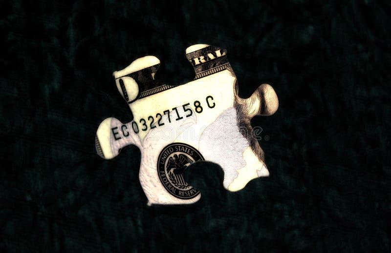 Puzzle 1 dei soldi fotografia stock