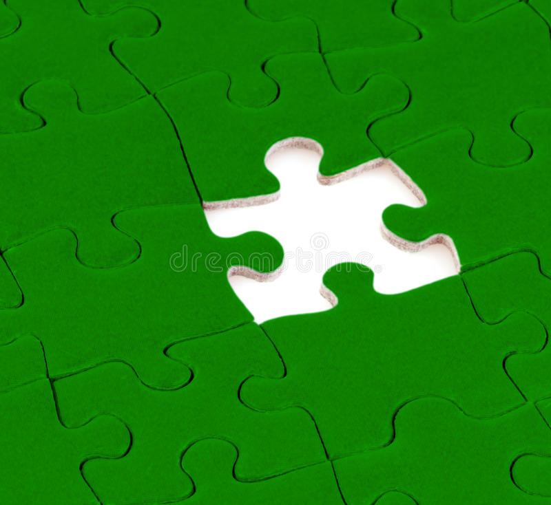 Puzzle. Green puzzle missing a piece