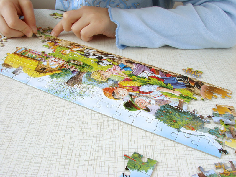 Puzzle assembling 4 royalty free stock photo