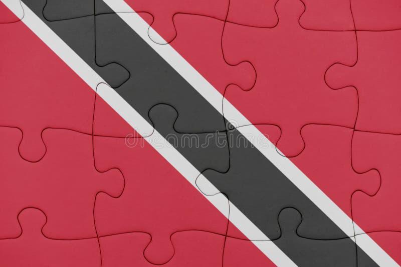 Puzzle avec le drapeau national des Trinit?-et-Tabago images stock
