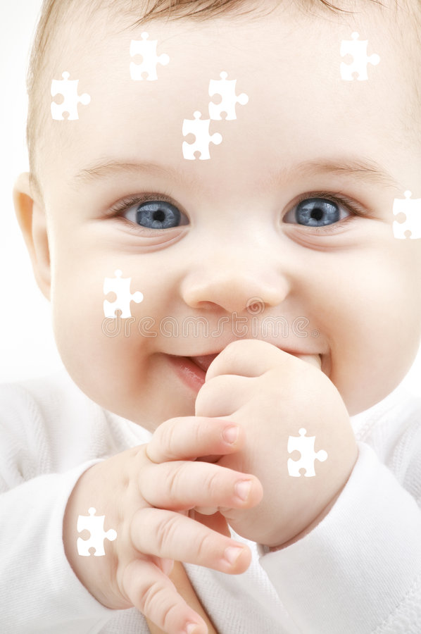 Puzzle baby. Puzzle portrait of adorable smiling baby stock photos