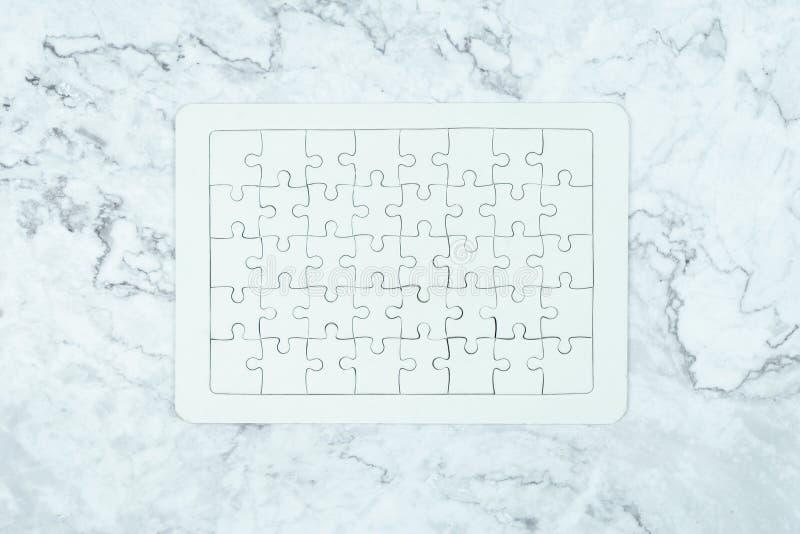 Puzzle bianco su fondo di lusso immagine stock