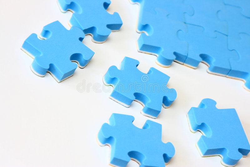 Puzzle bleu photos stock