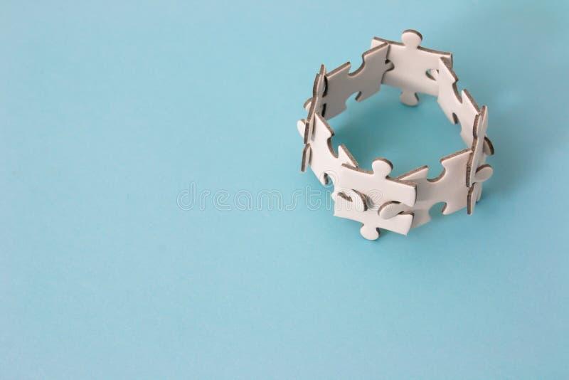 Puzzle concept teamwork stock photos