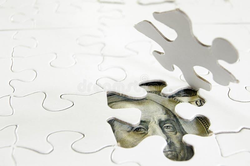 Puzzle d'argent photos stock