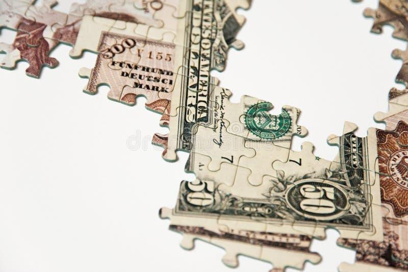 Puzzle d'argent photo stock