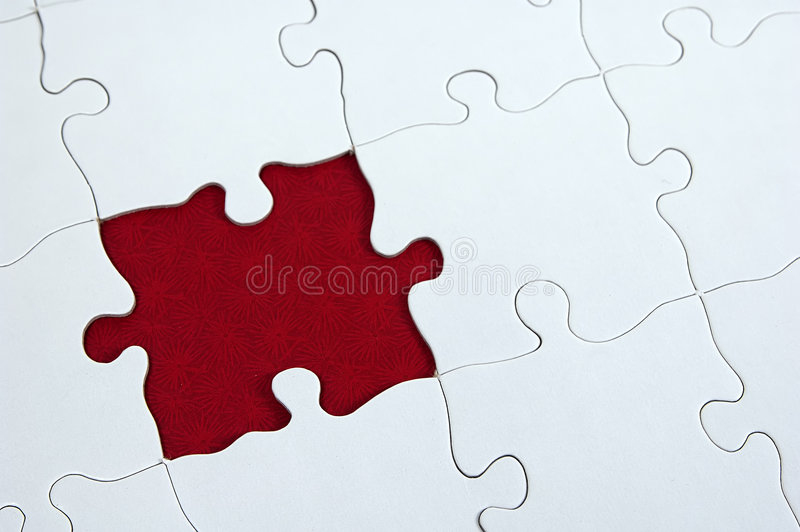 Puzzle - Dar Red. Photo of a Puzzle Missing a Piece With a Dark Red Background royalty free stock photo