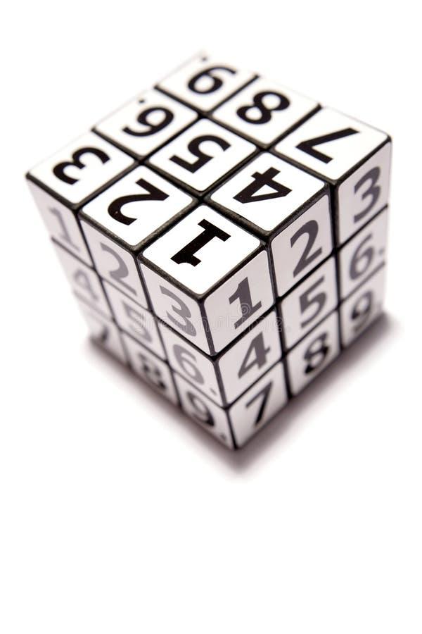 Puzzle del cubo di numero immagini stock