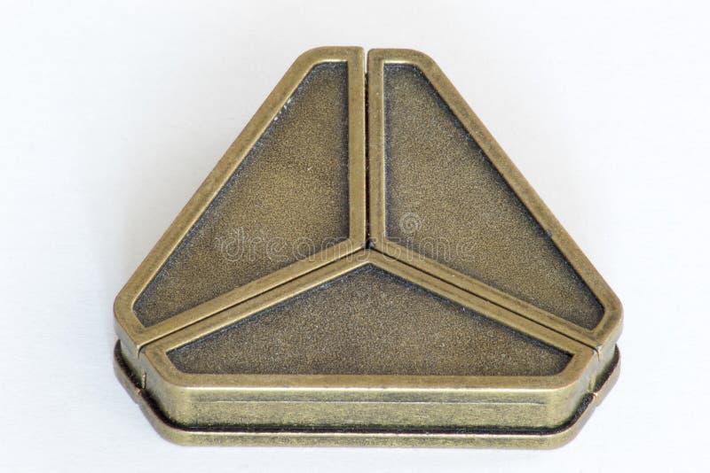 Puzzle del triangolo del ghisa fotografia stock libera da diritti