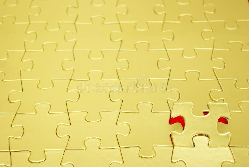 Puzzle Dell Oro Fotografia Stock Libera da Diritti