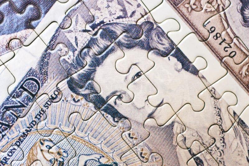 Puzzle della banconota fotografie stock
