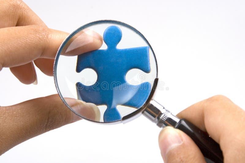 Puzzle denteux de agrandissement image stock