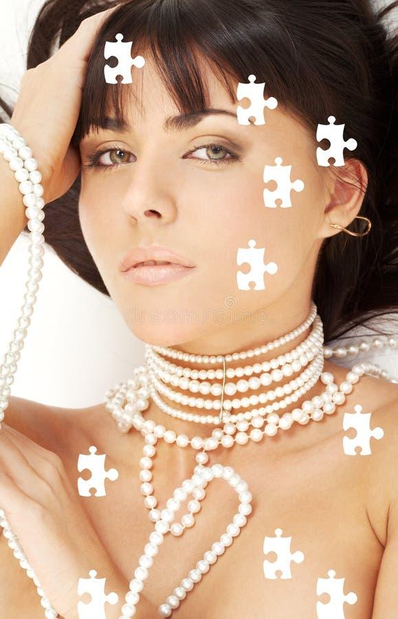 Puzzle di desiderio della perla fotografia stock