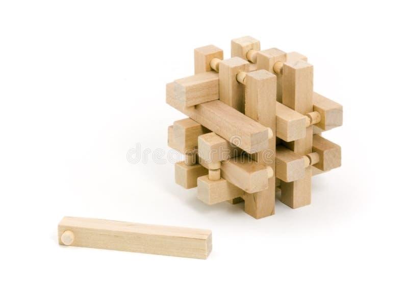 Puzzle di legno con una parte tirata fotografia stock libera da diritti