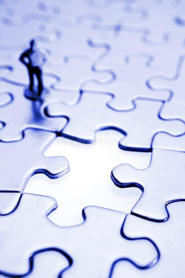 Puzzle ed uomo fotografia stock libera da diritti