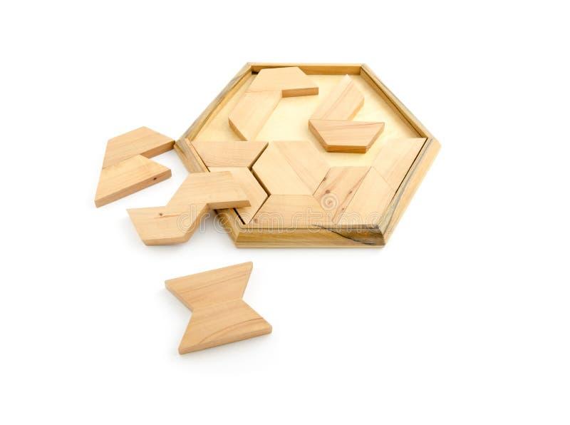 Puzzle en bois d'isolement sur le blanc photos stock