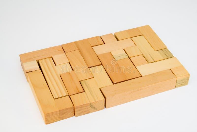 Puzzle en bois de finition photographie stock