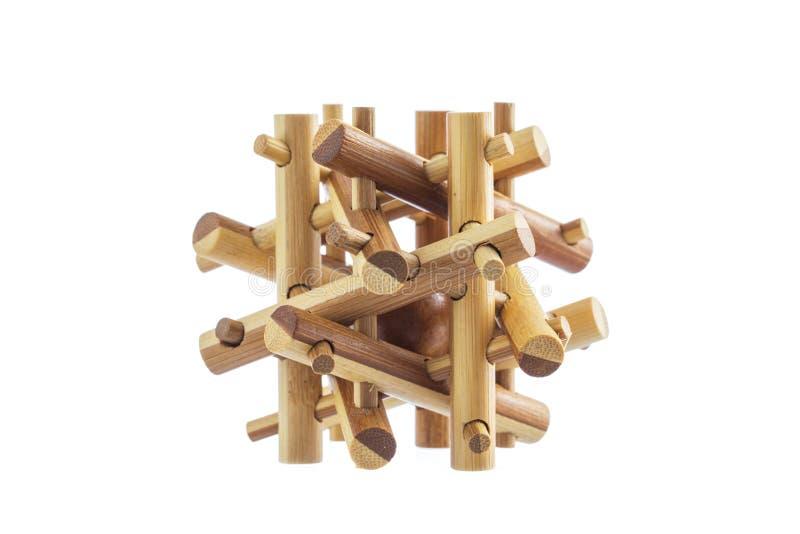 Puzzle en bois, jeu logique de jouet d'isolement sur le fond blanc image stock