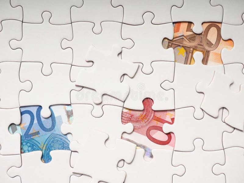 Puzzle financier photo stock