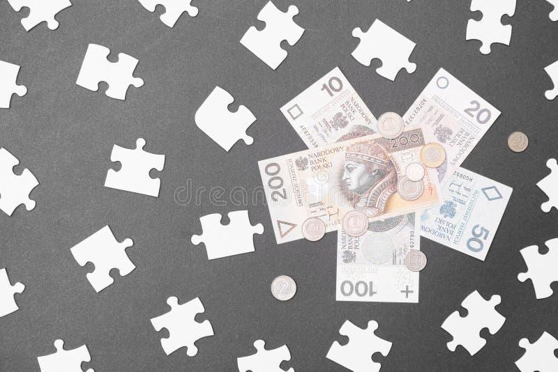 Puzzle finanziario polacco immagine stock