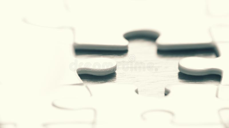 Puzzle game concept background. A puzzle game concept background in black and white stock image