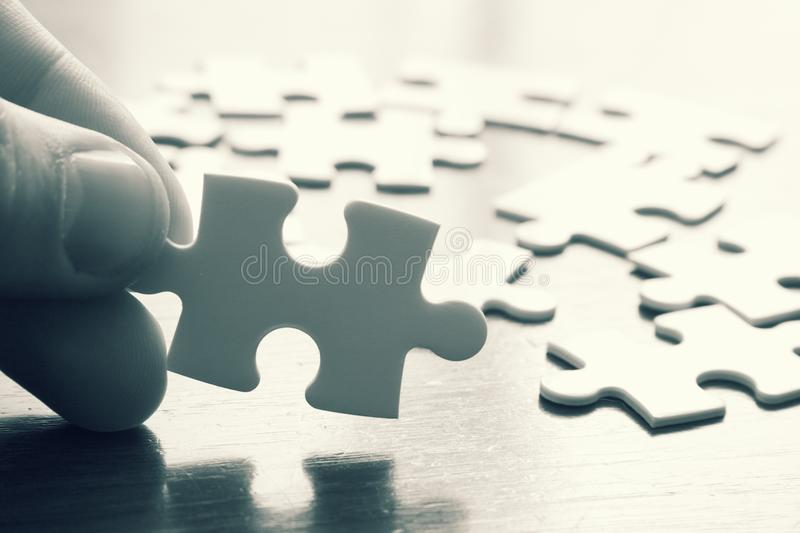 Puzzle game concept background. A puzzle game concept background in black and white royalty free stock photos