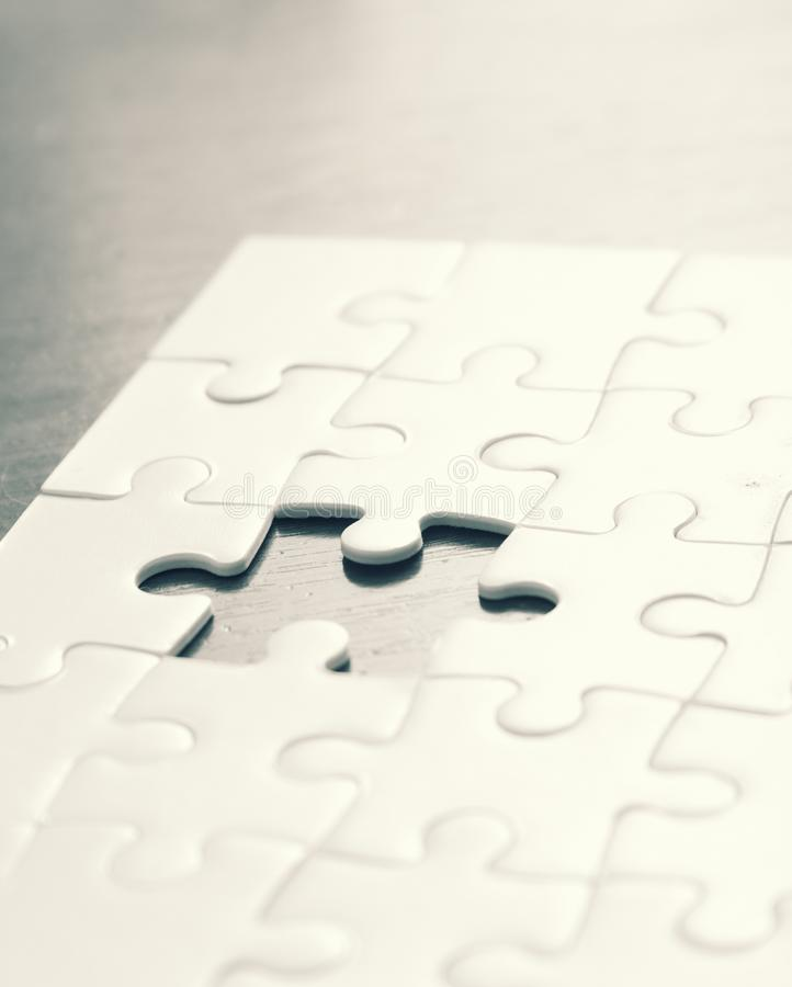 Puzzle game concept background. A puzzle game concept background in black and white stock photography