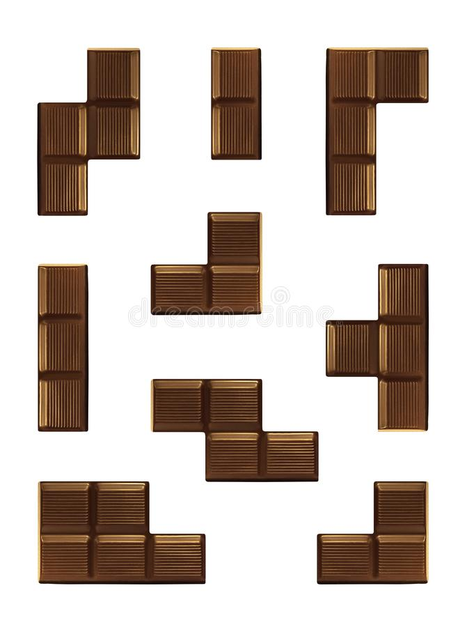 Puzzle game with falling chocolate pieces. Isolated on white background royalty free stock image