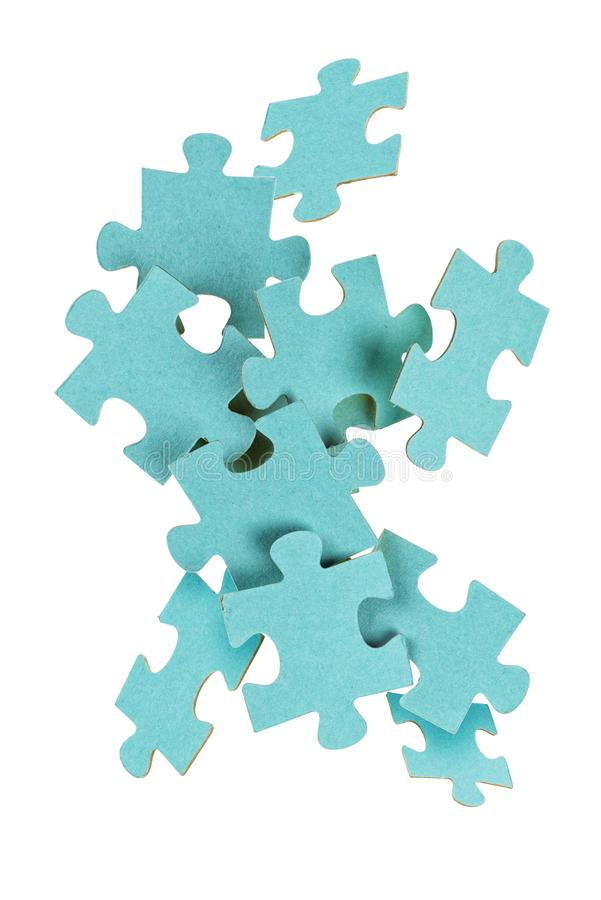 Puzzle game isolated on white. Flying puzzle game parts isolated on white background stock photo
