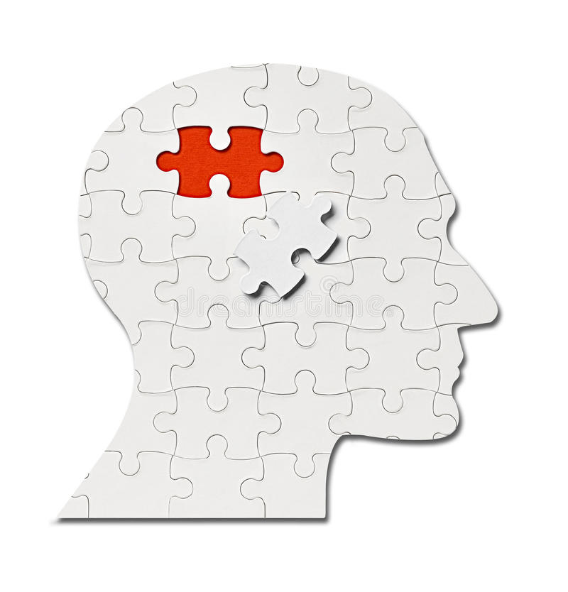 Puzzle game solution head silhouette mind brain. Close up of a puzzle game parts on a head silhouette stock images