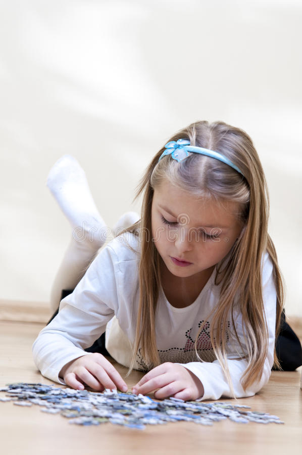 Puzzle girl stock photography