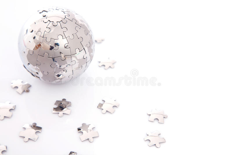 Puzzle globe on white royalty free stock photo