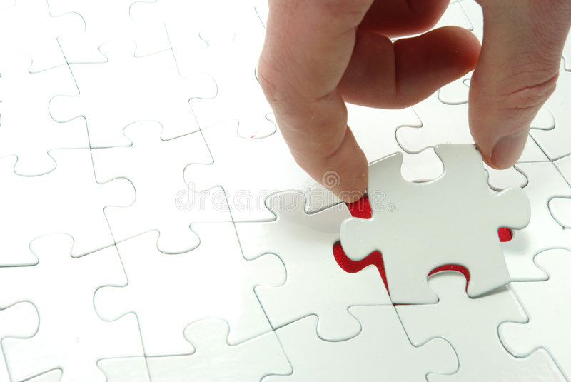 Puzzle in hand. Hands holding a puzzle piece . business concepts stock image