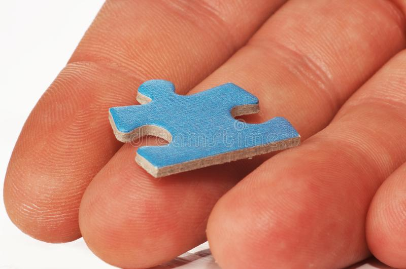 Puzzle In Hand Stock Photo