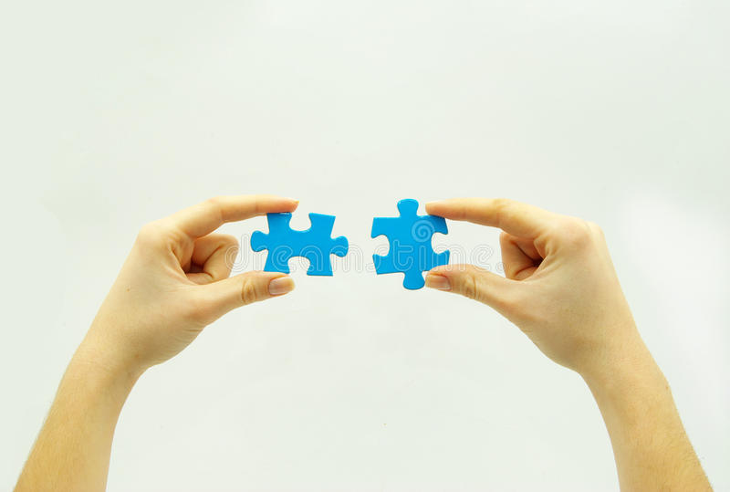 Puzzle in hands royalty free stock photos