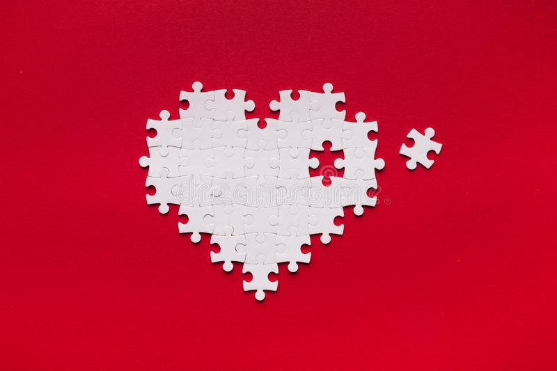 Puzzle heart with one missing piece, health care concept. Health care concept. Puzzle heart with one piece missing. Heart vitamines add royalty free stock photo