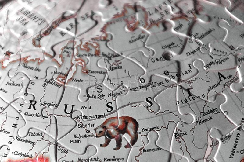 Puzzle Map and the Letters of the country name of Russia in black white red tint optic. Blackwhite red tint colored puzzle map of Russia. The letters and the royalty free stock images