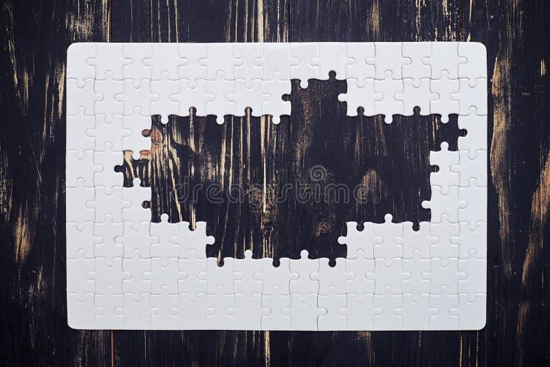 Download Puzzle Without Middle Part On Dark Wooden Desk Stock Illustration - Illustration: 70384597