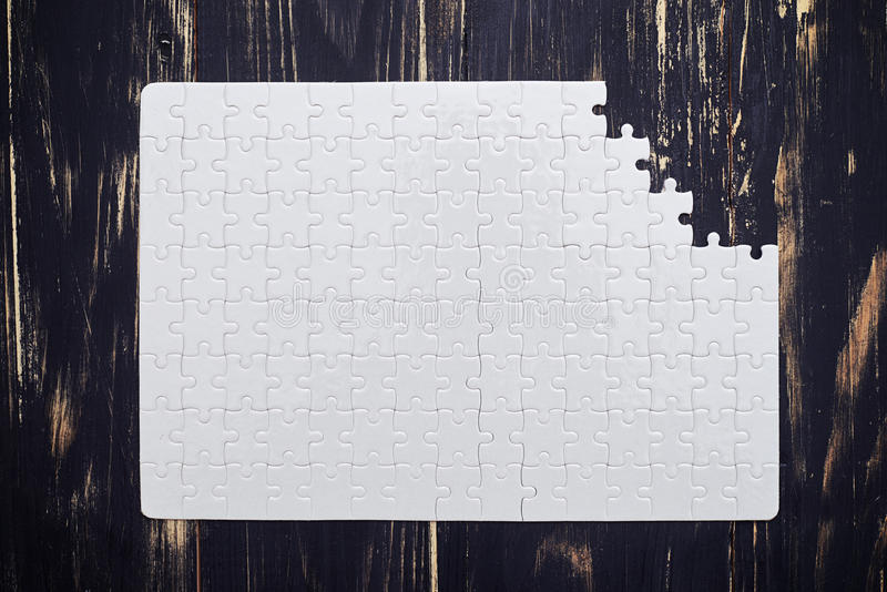 Download Puzzle With A Missing Part On Wooden Desk Stock Illustration - Illustration: 70384577