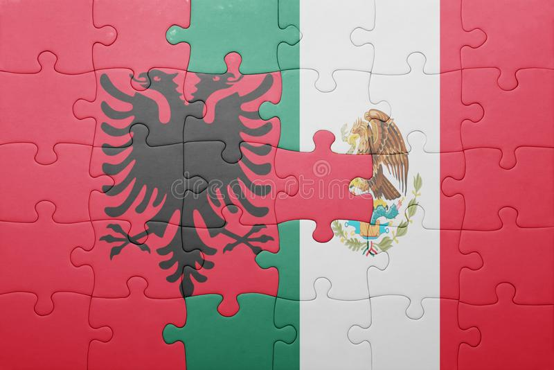 Puzzle with the national flag of albania and mexico. Concept stock images