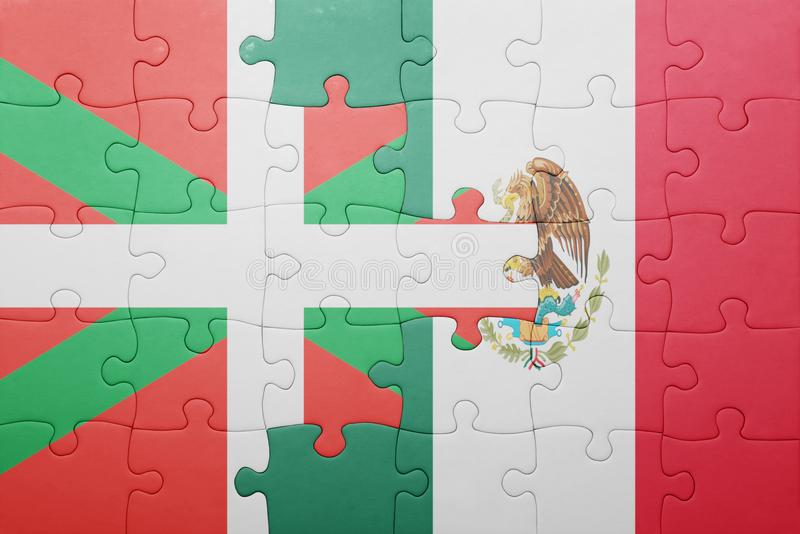Puzzle with the national flag of basque country and mexico. Concept royalty free stock image
