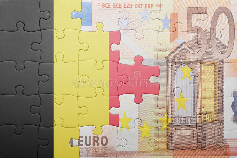 Puzzle with the national flag of belgium and euro banknote. Concept stock images
